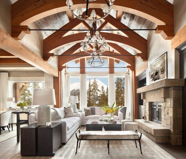 White furnishings and cabinetry mix well with classic stone and wood beams in this montana home