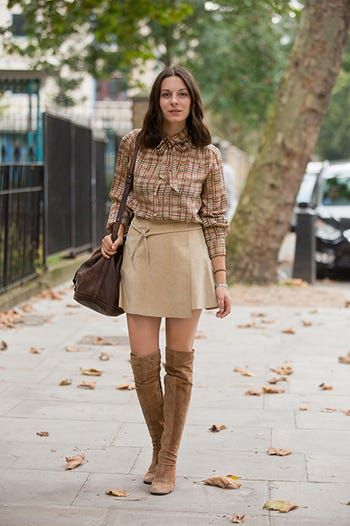 abc9bd0cdf4 Take a flat suede boot to the ultimate '70s place with a short wrap  miniskirt and a buttoned-up blouse. It's sexy but sharp.