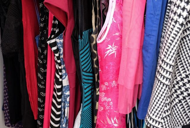 A glimpse of my closet. I rarely deviate from my clothing palette. Black,  black and white, bright blue, bright pink, purple, and the occasional bit  of teal ... f214bf49fb