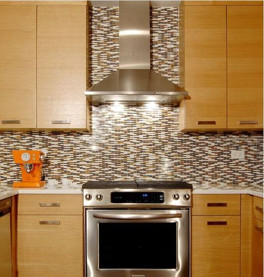 A Sleek Stainless Steel Chimney Hood With Tile That Goes Up To The Ceiling Is Contemporary Look Makes Range Focal Point