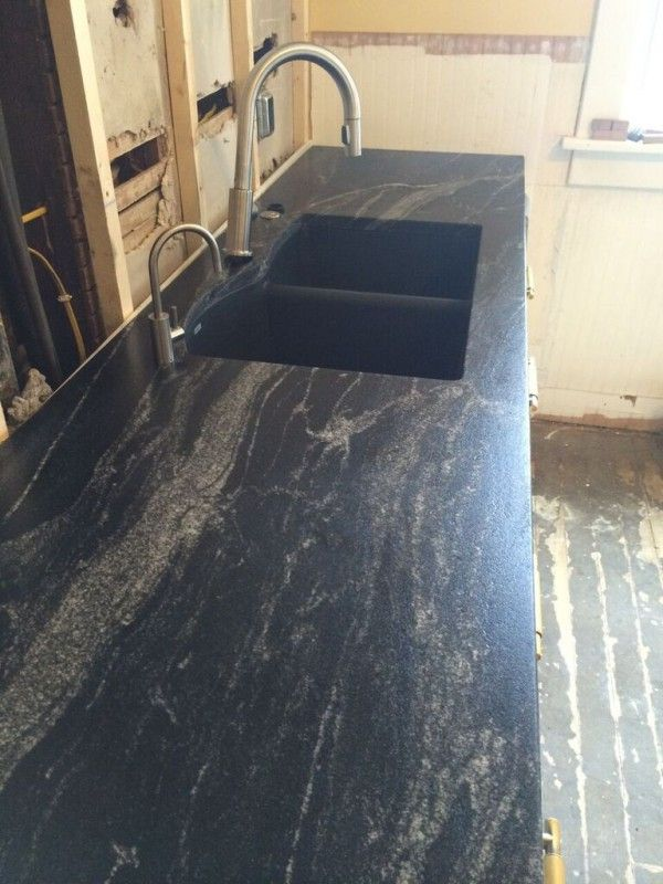 For the countertops, we wanted something with a matte black finish ...
