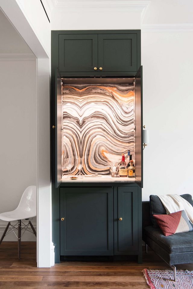 Above A Cocktail Cabinet Between The Kitchen And Living Room Is Lined In Swirls Wallpaper By Robert Crowder Chosen Projects Interior Designer