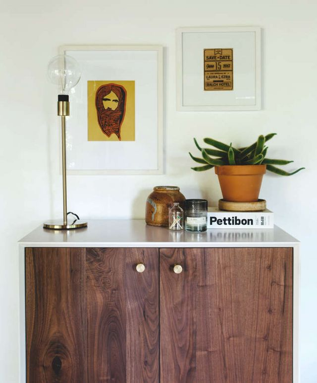 Above A Walnut Cabinet With Lacquered White Top Serves As Base For Vignette Of Art Lighting And Vases Photograph By Luke Mallory Photography