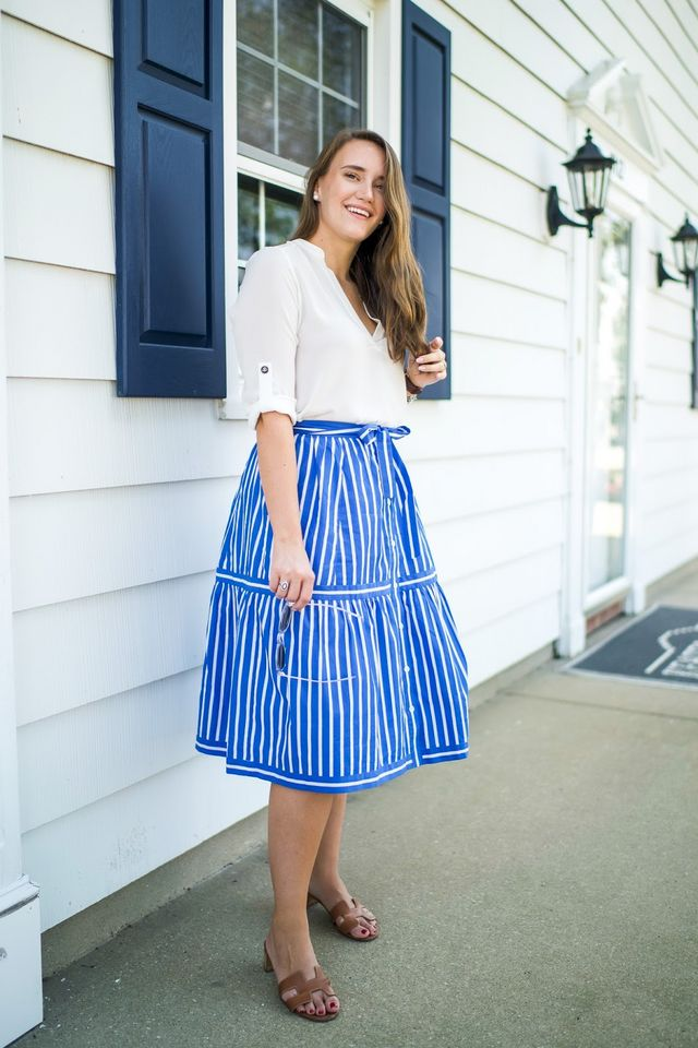 c64e637db99 Lush  Roll Tab Tunic (pocket style HERE and identical HERE)   J. Crew   Button Front Stripe Skirt   Hermes  Oasis Slides (dupe for  25 HERE)   YSL   Retro ...