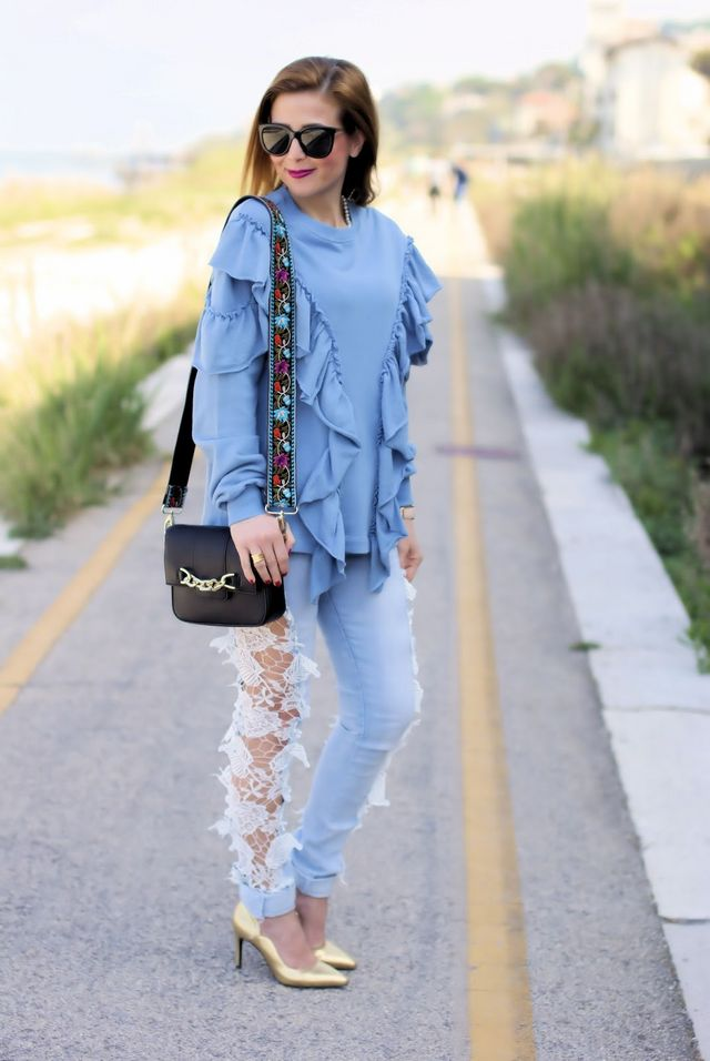 Lace cut out jeans and ruffled sweatshirt