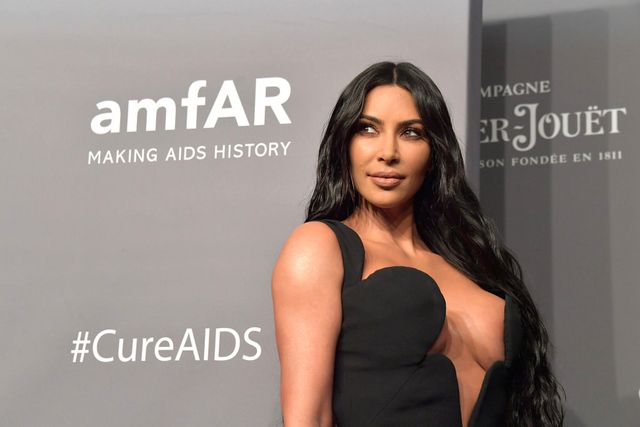 49ca79efab34 Kim Kardashian in Vintage Versace at the 2019 amfAR New York Gala ...