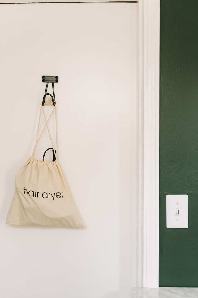 9b74841c5c47 -A hair dryer (see below for the cute bag I found for mine!) -Space to  unpack bags and hang some things. -Iron. -Wine bottle opener (lol … but  seriously)