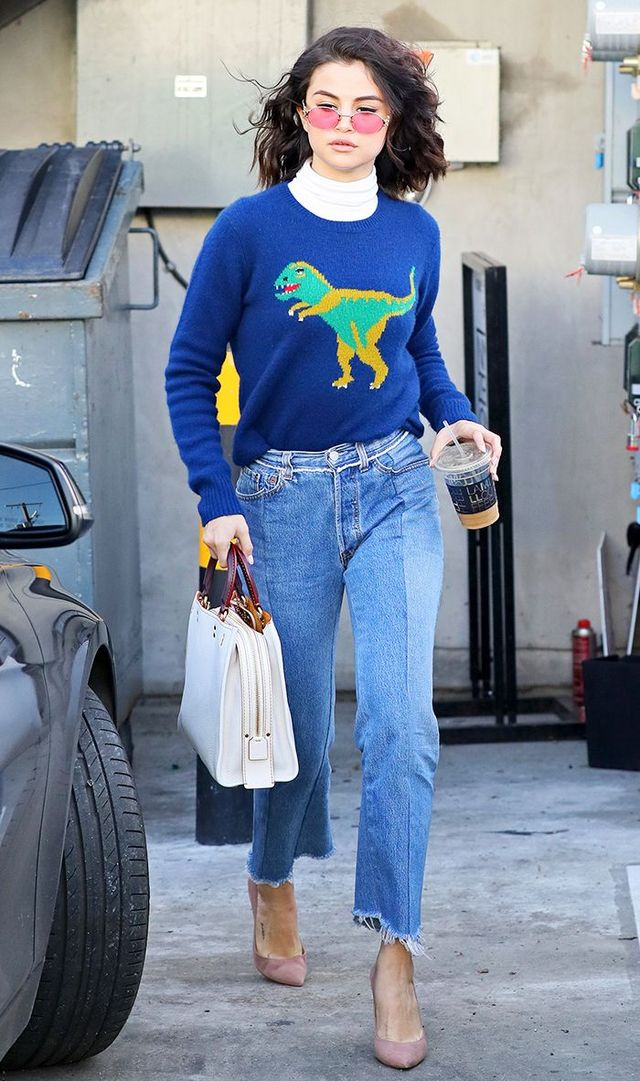 5e690dbf164 On Selena Gomez: Caviar 8860 Midas Series Sunglasses ($300); Coach Dinosaur  Motif Crewneck Sweater ($695); Vetements jeans; Kurt Geiger Ellen Taupe  High ...