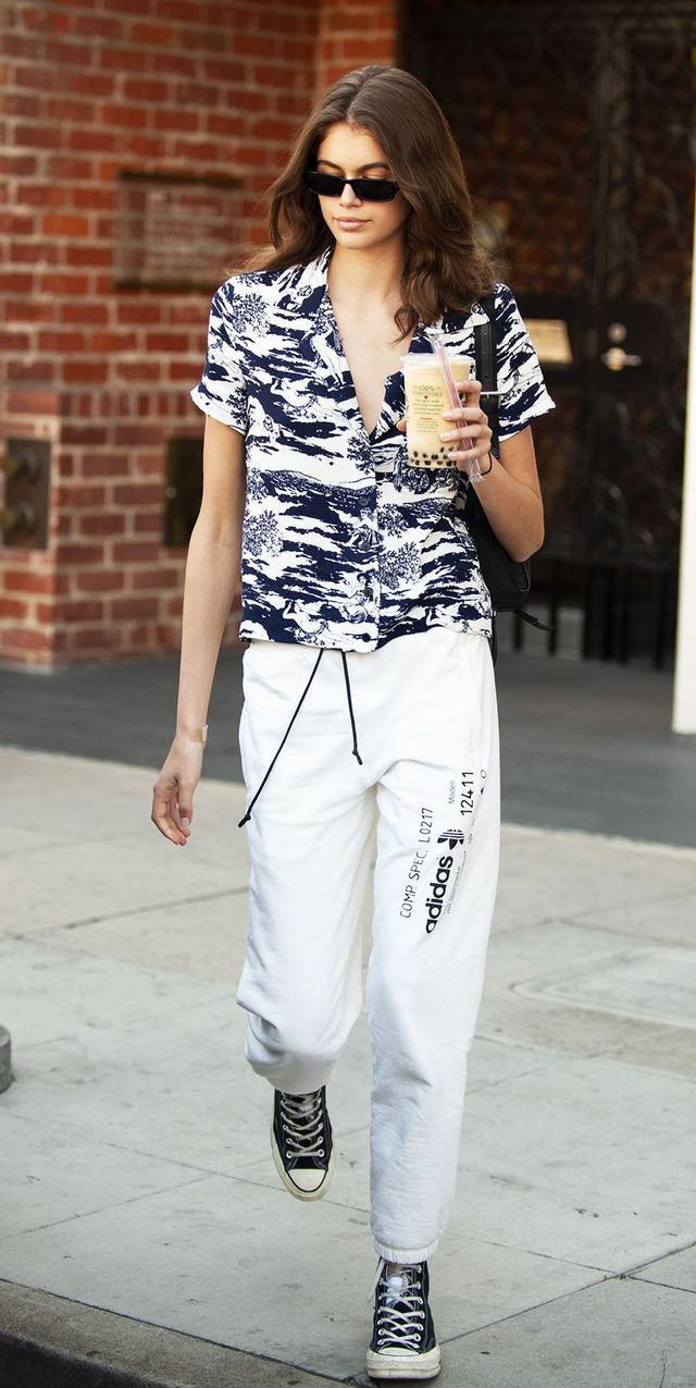 4894d8ad6557 On Kaia Gerber  Palm Angels x Moncler sunglasses  Reformation Cuba Top  ( 128)  Prada belt bag  Adidas By Alexander Wang Graphic Joggers ( 150)   Converse ...