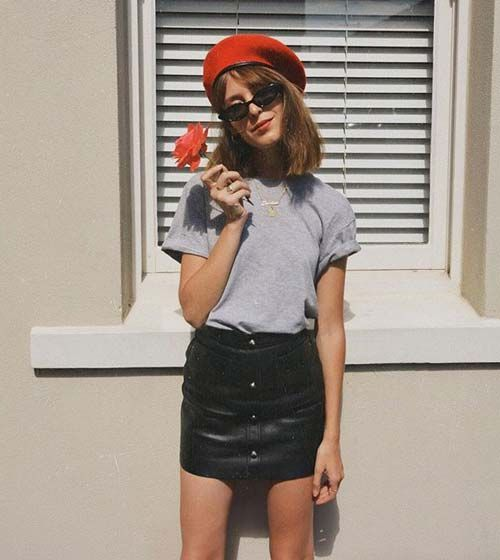 8fa7ea053 Leather skirts and T-shirts just scream cool. Bonus points if you add a  beret.