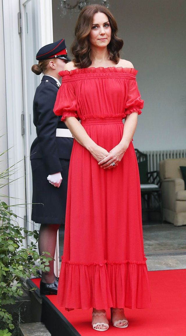 5b58642f83f9 Style Notes: On the royal tour of Germany, Kate opted for a more  fashion-forward outfit for her evening look, wearing an off-the-shoulder  red maxi gown by ...