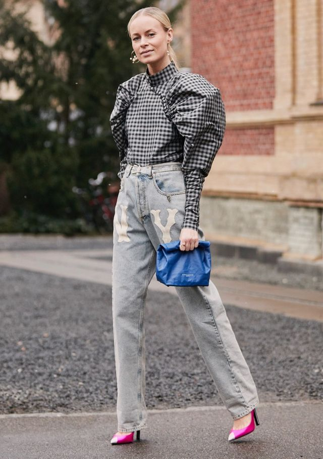 d8660fbc528 A bright pair of plaid pants deserves an equally eye-catching jacket with  structured sleeves. Use a white mock-neck top as a base layer and cap it  all off ...