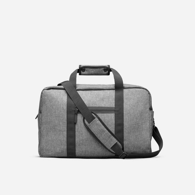 df754420c3 ... this weekender features a water-resistant fabric that s on the thinner  side (aka light) but sturdy for frequent travels. This bag is also on ...
